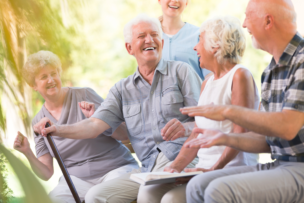 Group of seniors outside enjoying time together